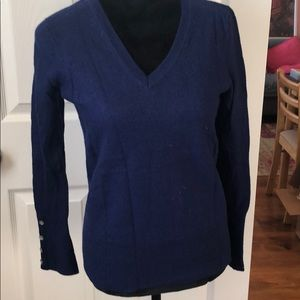 Navy sweater with buttons on the sleeves